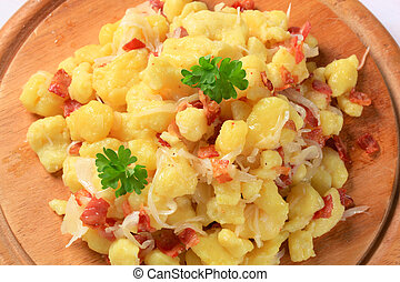 Small potato dumplings with bacon and cabbage - Small potato...
