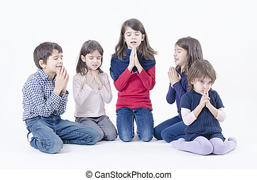 Children Pray - Five children praying isolated on white