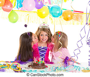 Children girls group in birthday party greetings with a kiss