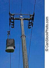 Ski Gondola and Pylon with blue sky - A ski cabin going up...