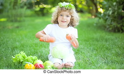 Happy child playing with fruits