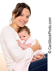 Baby girl relaxed with pacifier hug in mother arms on white...