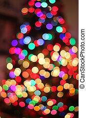 Blurred Christmas tree lights - Multi colored Christmas tree...