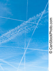 blue sky with contrails - lots of contrails in a blue sky...