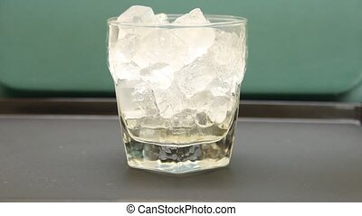 puring soda on ice - pouring a soda over a glass of ice