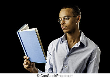 Young black male reading - Young african american black male...