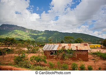 Southern Kenya poverty landscape Small houses in bad...