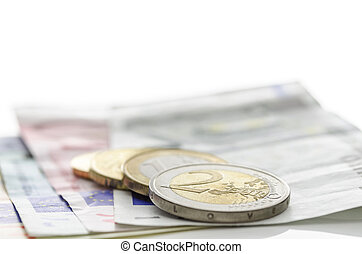 Euro coins on banknotes