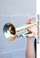 Trumpet player. - Trumpet player holding his instrument...