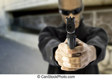 black male pointing gun at viewer - african american young...