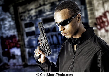 black male holding a handgun - Young black african american...