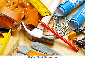 set of building tools on wooden boards