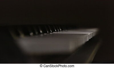 piano keyboard - Time lapse of spotted sunlight passing...