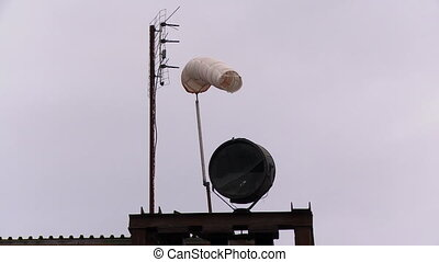 Old windsock and antennas - Old white windsock and antennas