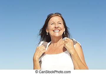 Beautiful mature woman active retirement - Portrait Active...