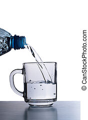 Running water - Water is running from bottle to glass cup...