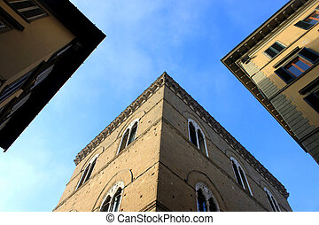building gaps in blue sky - a view from the buttom of...