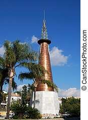 Copper obelisk, Marbella, Spain. - Copper obelisk in the...