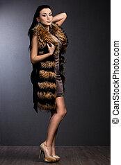 beautiful fashionable woman in fur