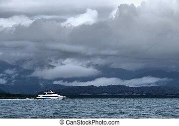 A tourist boat is leaving Port Douglas for the Great Barrier Reef on 4 January 2012, North Queensland, Australia