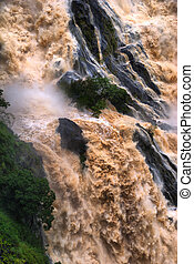 CAIRNS, AUSTRALIA - JAN 22 : Flooded Barron River entering...