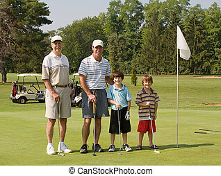 Family Playing Golf - Two Generations of Family Playing Golf...