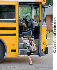 Little Boy Getting on Bus to go to School