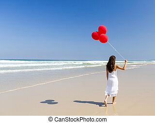 Walking with ballons - Beautiful girl walking in the beach...