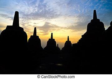Borobudur temple at sunrise - Old Buddhist temple Borobudur...