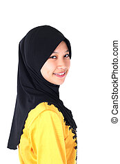 Close-up portrait of young Asian Muslim girl smiles with...