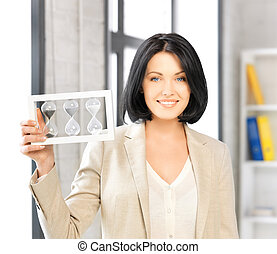 businesswoman holding hourglass - picture of attractive...