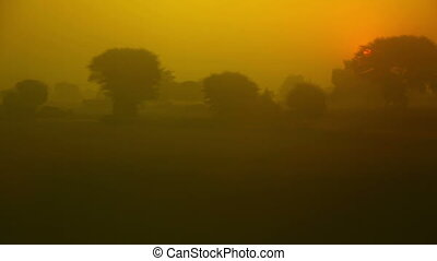 Hazy dawn. - Hazy dawn in Dehli outskirts shot from moving...