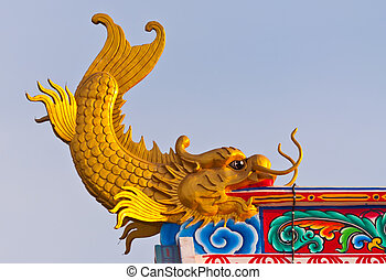 Dragon fish statue on the roof of Chinese temple