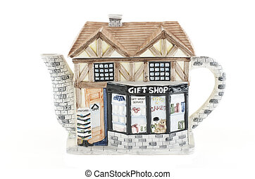 Porcelain teapot in the form of a house.