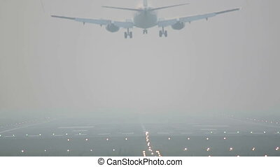 Landinig in the mist. - Jet airliner landing in the thick...