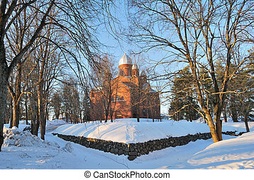 Finland. Lappeenranta Lutheran Cathedral at sunset -...