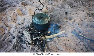 Boiling pot of water on the fire