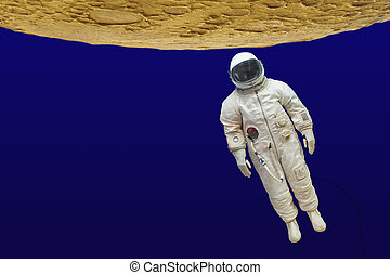 astronaut in a spacesuit under the open space