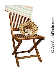 deck chair with towel and seashells