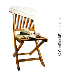 chair with hat,towel and seashells