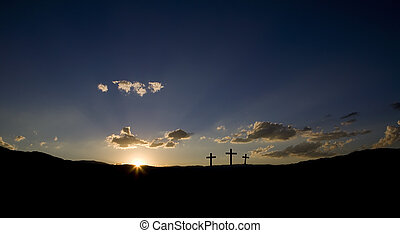 Easter Sunrise  - Sun rising on three Christian crosses.