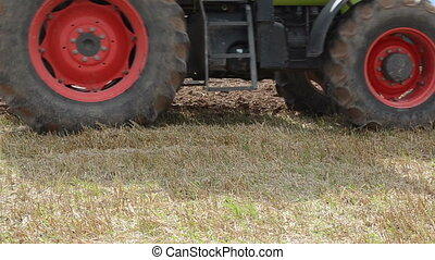 closeup tractor plough - closeup of tractor wheel and plough...