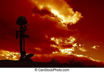 Fallen Soldier Memorial - An AR-15 rifle with combat helmet...