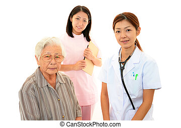Medical staff with old woman