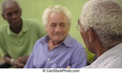 Group of old men meeting, talking
