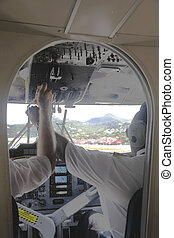 Small Plane Cockpit with Crew during take-off