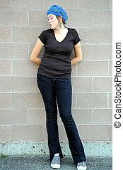 Female tomboy. - Female tomboy posing outside.