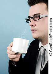 Coffee break - Young businessman taking a coffee break