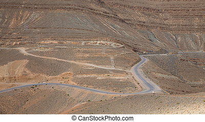 Mountain road - curved road across desert mountain in...