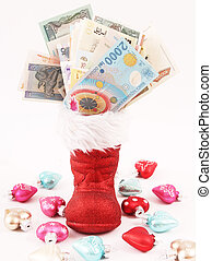 Santa Claus shoe - A red Santa Claus shoe with bills from...